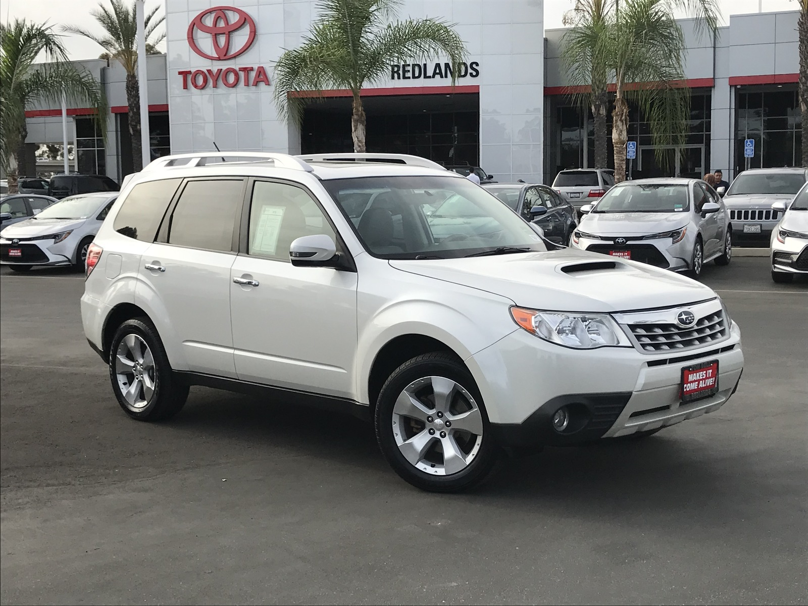 Pre-Owned 2011 Subaru Forester 2.5XT Touring